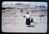 A Navajo woman, girl, and baby.