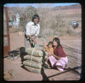 A Navajo couple and a baby at St. Christopher's Mission.