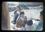 A group of Navajo children and two women;