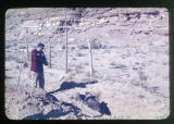 A Navajo man at a gravesite.