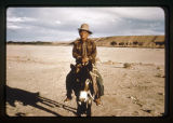 A Navajo man on a burro.