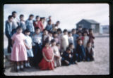 A group of Navajo men and women posing for a photograph;