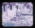 Father Liebler and two other men working on the mission house.