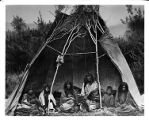 Family group in tipi, Bannock Tribe, 1871
