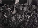 Group of Navajo people with two white men [1];