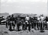 Group of Navajo men on horseback at the airport;