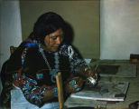 Zuni woman silversmith setting turquoise in inlaid bracelet [2]