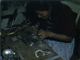 Navajo woman silversmith makes Zuni type inlaid butterfly pin;