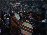 Christmas Party- Heflin's, December 21, 1946, Navajo men and women line up to receive presents of...