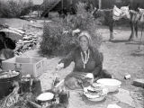 Old Navajo woman making fried bread at 4th of July celebration [2];