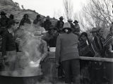 Group of Navajo people at a party waiting in line to be served food [1];