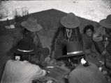 Navajo men gambling at Gouldings