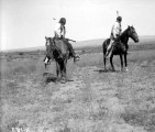 Ute men on horseback