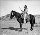 Ute man with rifle