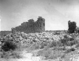 Ancient cliff ruins built of dressed standstone on high mesa were probably forts, but no one knows...
