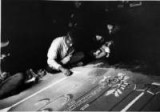 Indian working on sand painting at Santa Fe, New Mexico