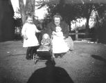 Life in the West-Woman, Children, and Doll Stroller