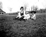 Life in the West-Woman and Children Sitting on Grass