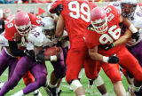 (49) Jason Hooks, (96) Vince Tauanuu in winning effort over TCU, 21-7.