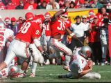 (35) Robert Love and (98) Toni Fatafehi   pounce on New Mexico Q