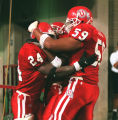 (24) Omar Bacon is congratulated by (59) Doug Kaufusi photo by Ravell Call