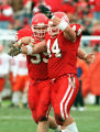 (44) Andy Kassitis and (55) Darren Walker celebrate